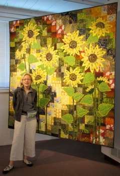 Katherine Knauer with her quilt Solar City at Quilt National 2013.