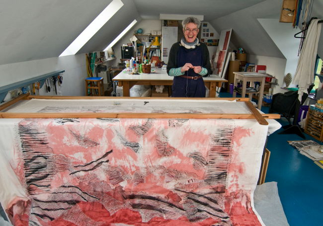 Pauline Burbidge in her studio with her quilt Lindsfarne Revisited